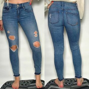 Express Mid Rise Destroyed Skinny Jeans